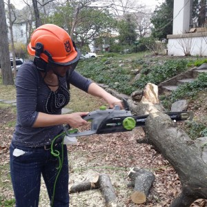Summer using chainsaw